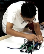 image of student with Lego robot